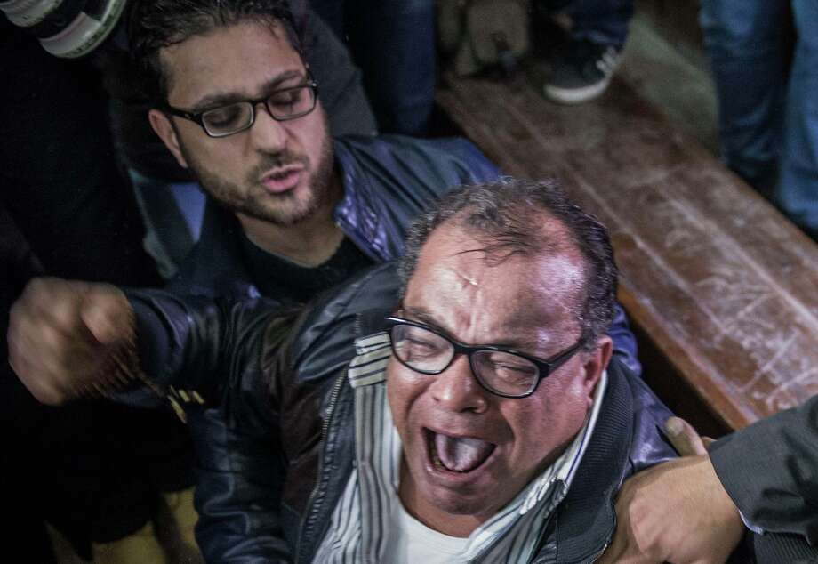 A supporter of Egyptian activist Alaa Abdel Fattah reacts to the verdict in his trial at a police institute in Cairo's Tora prison. Photo: KHALED DESOUKI / AFP / Getty Images / AFP