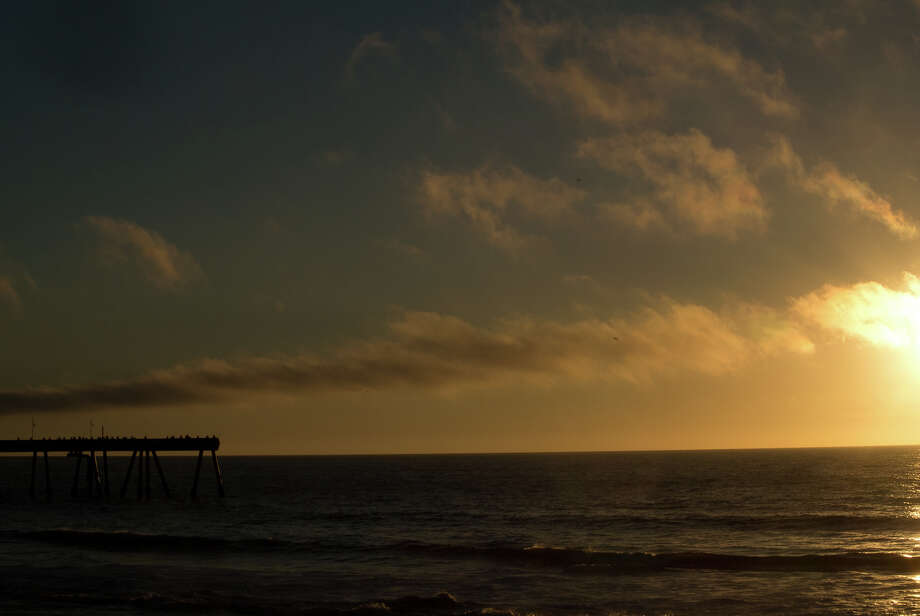 The Pacifica Pier at sunset. It's been called one of the best fishing piers in California. Photo: MIKE MOFFITT