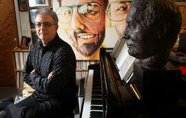 Composer and contemporary music impresario Charles Amirkhanian sits in his studio, Wednesday February 8, 2012, in El Cerrito, Calif.