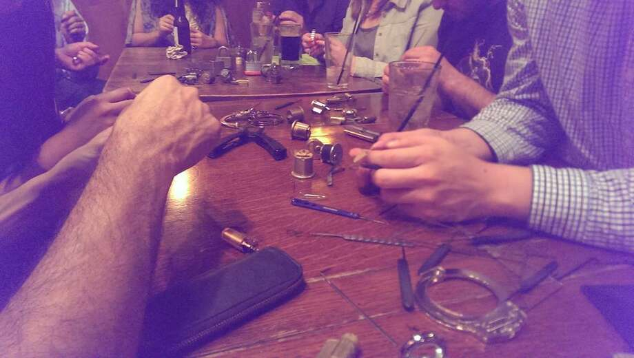 """A group of Houston lock picking enthusiasts meets up once a month at the Stag's Head Pub off Portsmouth to eat, drink, and pick locks for fun. Dennis Maldonado with Houston Locksport organizes the monthly meet-ups. """"Some people will join us to learn lock picking for first time, as we are constantly teaching, and others who are experienced just come to pick locks, have a drink or some food, and hang out,"""" says Maldonado. Photo: Houston Locksport"""