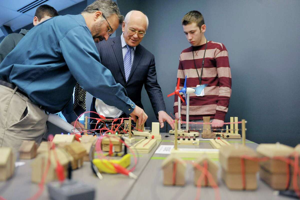 Teacher John Hartnett, left, and Tech Valley junior Thomas Clark, right, shows Congressman Paul Tonko, a model that has a network of different sources of energy, different demands on the energy and different ways to connect to the energy at Tech Valley High School on Monday, Feb. 23, 2015, in Albany, N.Y. (Paul Buckowski / Times Union)