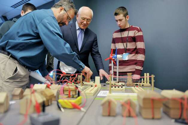 Teacher John Hartnett, left, and Tech Valley junior Thomas Clark, right, shows Congressman Paul Tonko, a model that has a network of different sources of energy, different demands on the energy and different ways to connect to the energy at Tech Valley High School on Monday, Feb. 23, 2015, in Albany, N.Y. (Paul Buckowski / Times Union) Photo: PAUL BUCKOWSKI / 00030720A