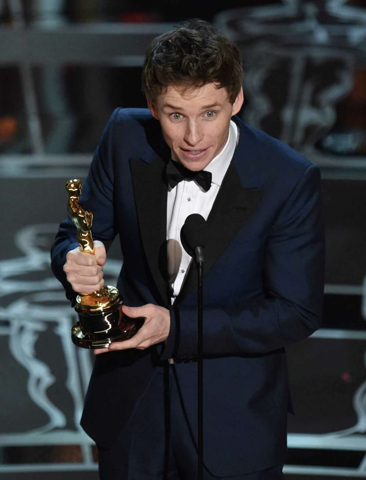 Eddie Redmayne accepts the award for best actor in a leading role for ?