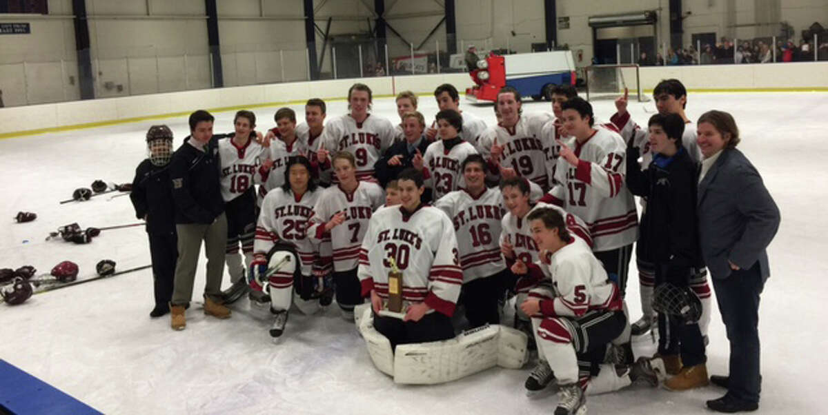 The St. Luke's boys hockey team poses with their trophy following their 5-3 win over Rye County Day for the FAA championship.