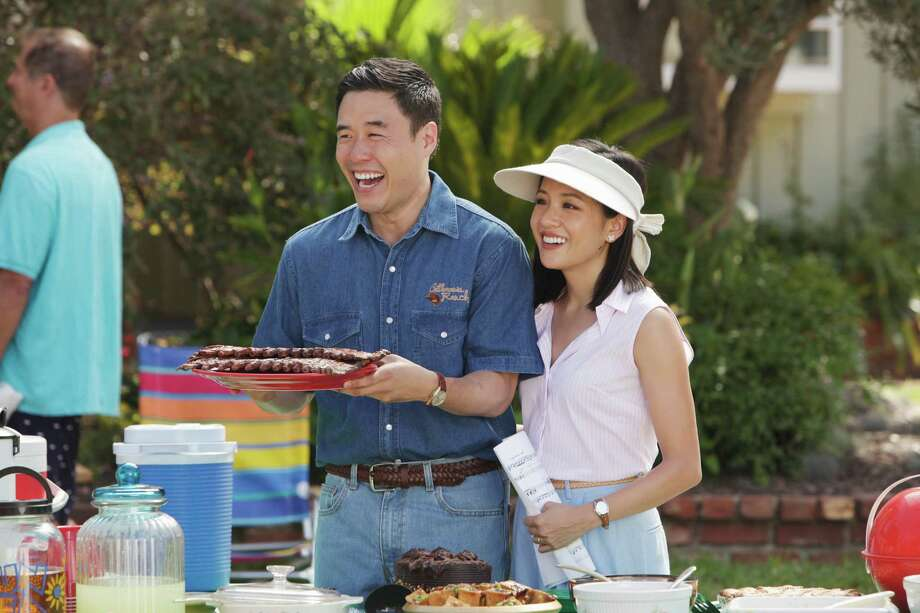 """In this image released by ABC, Randall Park, left, and Constance Wu appear in a scene from the new comedy series """"Fresh Off the Boat,"""" previewing Wednesday with episodes at 8:30 p.m. and 9:30 p.m. EST. Photo: Nicole Wilder /Associated Press / American Broadcasting Companies,"""