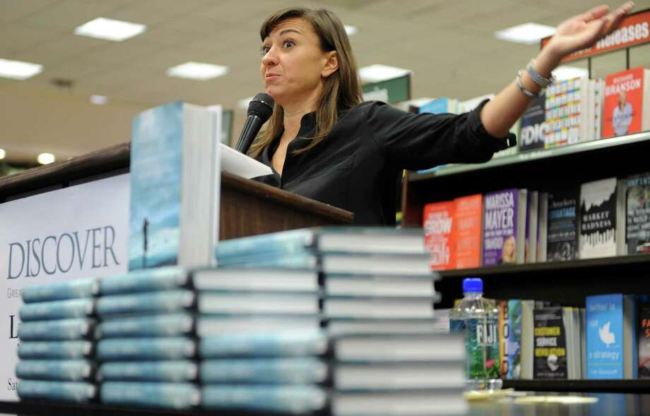 "Lynsey Addario, a Westport native and Pulitzer Prize and MacArthur Fellowship winner, on Saturday spoke and signed copies of her new memoir ""It's What I Do: A Photographer's Life of Love and War"" at the local Barnes & Noble store. Photo: Autumn Driscoll / Westport News"