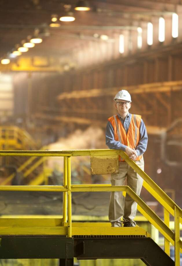 Bruce Shaffer (cq), Human Resources Director for Tenaris stands along a pipe manufacturing assembly line Tuesday, April 13, 2010, in Conroe. Tenaris was able to change the work share during the down turn a couple of years ago to keep employees. They are able to sustain their work force to be productive in the current upturn. ( Nick de la Torre / Chronicle ) Photo: Nick De La Torre, Houston Chronicle