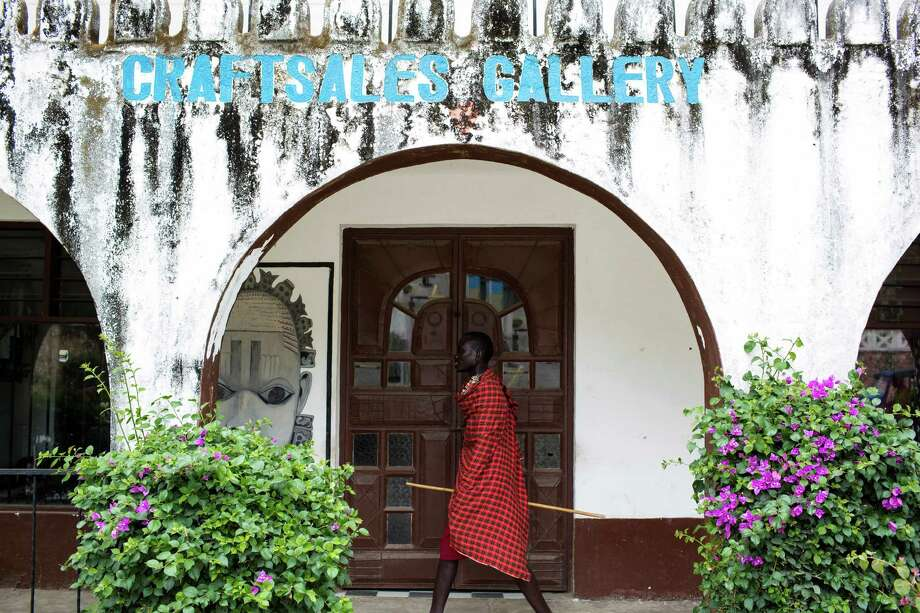 """A Masai man walks past a closed craft gallery in the Shanzu area in Mombasa, Kenya, Feb. 3, 2015. Kenya's coastal tourism is collapsing amid Western travel warnings of possible terrorist threats that Kenyan officials say amount to """"economic sabotage."""" (Ivan Lieman/The New York Times) Photo: IVAN LIEMAN / New York Times / NYTNS"""