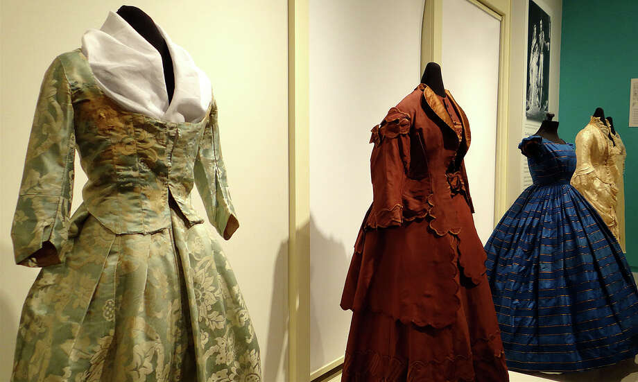 "Wedding dresses dating from 1781 to 1916 are displayed in a new exhibit, ""Fashion & Fantasy: 250 Years of Wedding Dresses,"" at the Fairfield Museum and History Center. Photo: Mike Lauterborn / Fairfield Citizen"