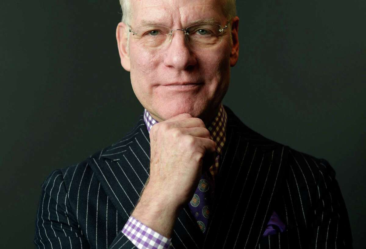 Fashion star and TV host Tim Gunn strikes a pose at the 4th annual Goodwill Fashion Show at the Exdo Event Center in Denver on Feb. 6, 2014.