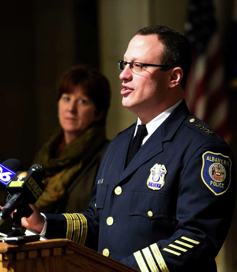 As Albany Mayor Kathy Sheehan watches, left, Albany Police Chief Steven Krokoff announces his retirement from the department during a press conference Monday morning, Feb. 23, 2015, at Albany City Hall in Albany, N.Y.  Chief Krokoff will be replaced by Acting Chief Brendan Cox. He leaves April 1. (Skip Dickstein/Times Union) Photo: SKIP DICKSTEIN / 00030721A