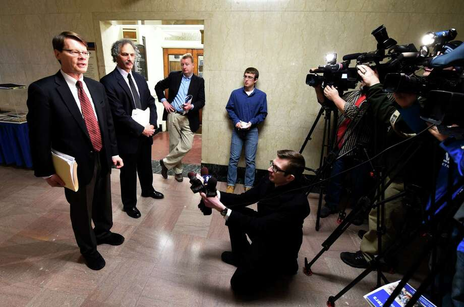 Blair Horne, left, of NYPIRG conducts a press conference to call on the Governor to restrict lawmakers' outside income in the same manner as Congress Monday morning, Feb. 23, 2015, at the Capitol in Albany, N.Y. (Skip Dickstein/Times Union) Photo: SKIP DICKSTEIN / 00030719A
