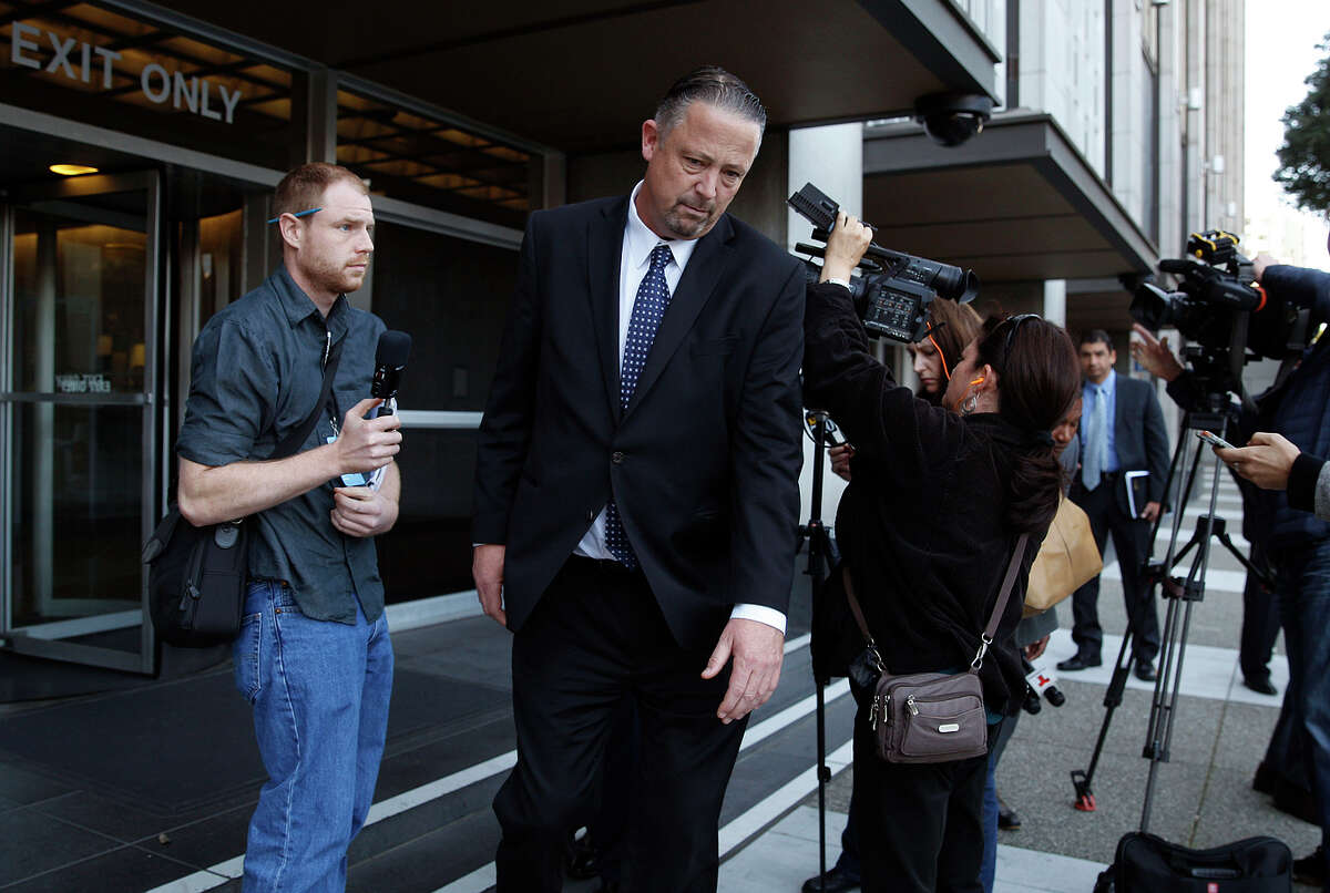 Former San Francisco police Sgt. Ian Furminger (center) leaves after speaking to reporters behind the Phillip Burton Federal Building and United States Courthouse after being found guilty of four felony charges.