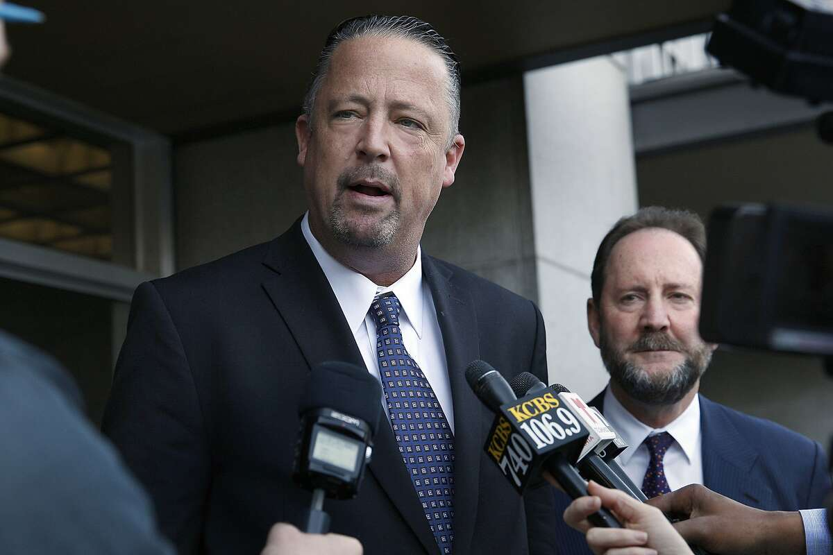 San Francisco police sgt. Ian Furminger (left) speaks to press in back of the Phillip Burton Federal Building & United States Courthouse in San Francisco, California on Monday, February 23, 2015. Sgt. Ian Furminger was found guilty of four felony charges today. At right is his lawyer Brian Getz.