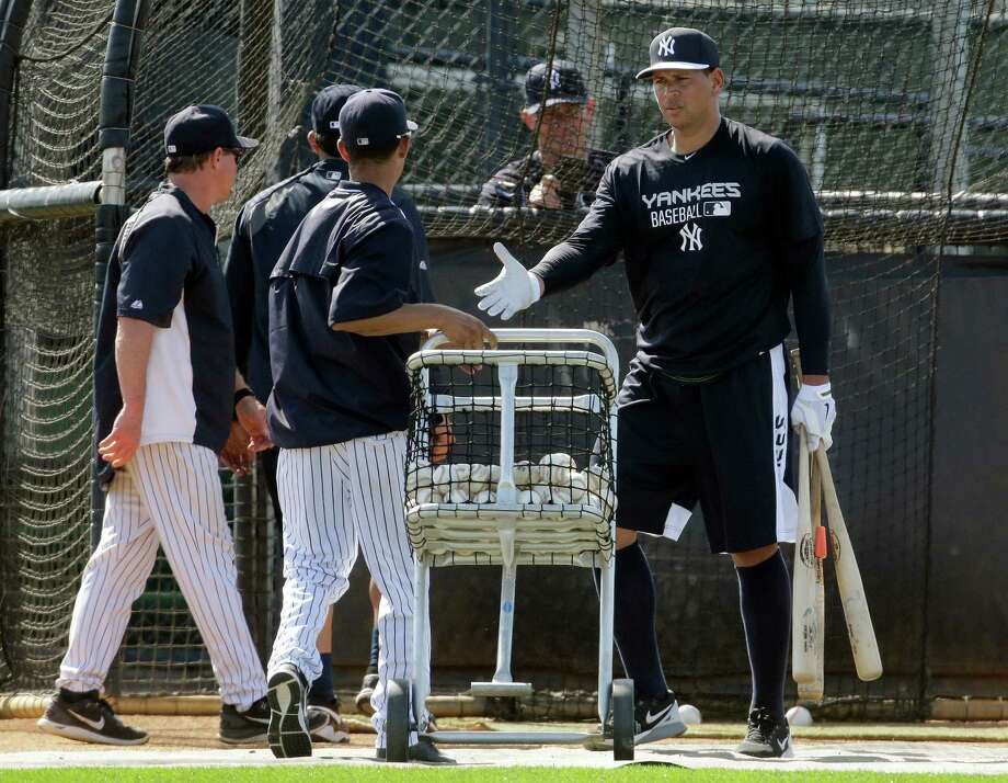New York Yankees third baseman Alex Rodriguez, right, shakes hands with coaches after working out at the Yankees' minor league complex Monday, Feb. 23, 2015, in Tampa, Fla. (AP Photo/Chris O'Meara)  ORG XMIT: FLCO107 Photo: Chris O'Meara / AP