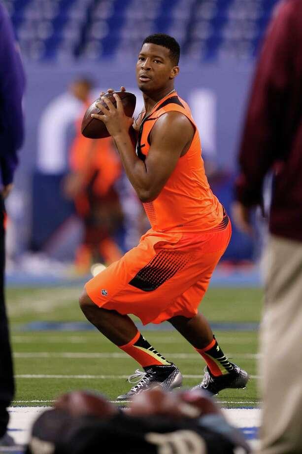 Florida State quarterback Jameis Winston runs a drill at the NFL football scouting combine in Indianapolis, Saturday, Feb. 21, 2015. (AP Photo/Julio Cortez) Photo: Julio Cortez, STF / AP