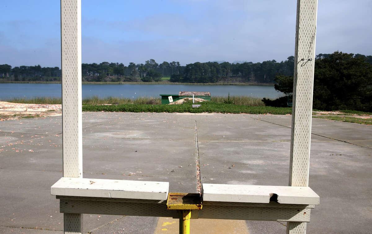 A trap-shooting station faces down range toward Lake Merced at the 80-year-old gun club.