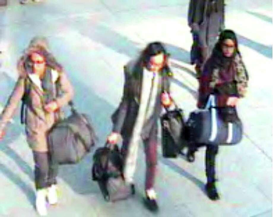 This photo taken from London TV shows Amira Abase, from left,  Kadiza Sultana and Shamima Begum heading for their flight to Turkey. Photo: Metropolitan Police, HOPD / Metropolitan Police