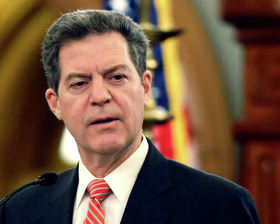 FILE - In this Jan. 15, 2015 file photo, Kansas Gov. Sam Brownback speaks at the Kansas Statehouse in Topeka, Kan. The Republican governor announced Tuesday, Feb. 10, 2015 that he issued an executive order rescinding a former governor's order barring discrimination against gays and lesbians in hiring and employment throughout much of state government. (AP Photo/Orlin Wagner, File) Photo: Orlin Wagner, STF / AP