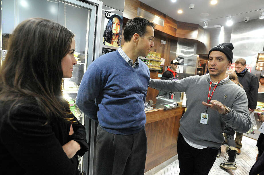Founder Marcus Antebi, right, chats with investor Mark Teixeira and his wife, Leigh, during an opening party for Juice Press on Greenwich Avenue in Greenwich, Conn., on Monday, Feb. 23, 2015. Juice Press is a vegan organic raw juice and smoothie bar. Photo: Jason Rearick / Stamford Advocate