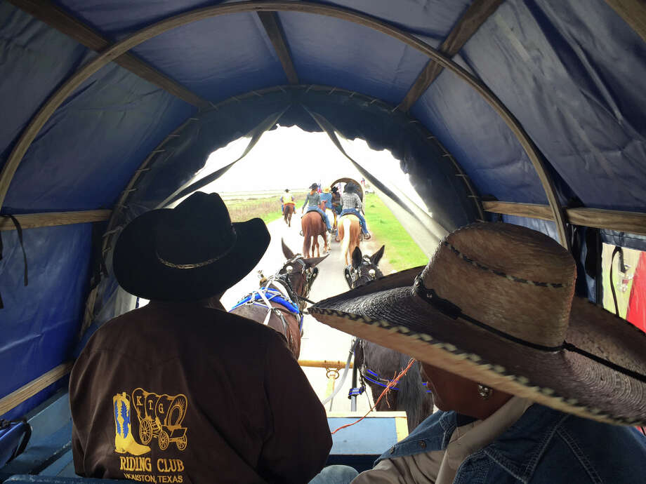 Arthur Gene Walker drives the wagon for the KTG Riding Club on Northeastern Trail Riders Association ride Sunday from Cheek to Devers. Photo: Leah Binkovitz