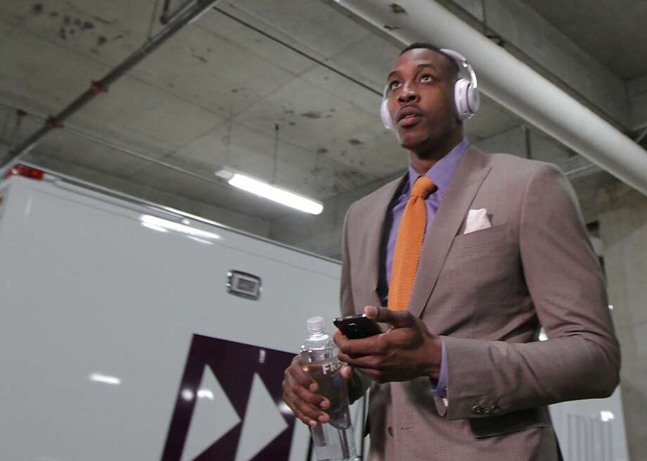 April 25 at Blazers Houston Rockets center Dwight Howard arrives before game three of the Western Conference Quarterfinals playoffs at the Moda Center Friday, April 25, 2014, in Portland. ( James Nielsen / Houston Chronicle ) Photo: James Nielsen, Houston Chronicle