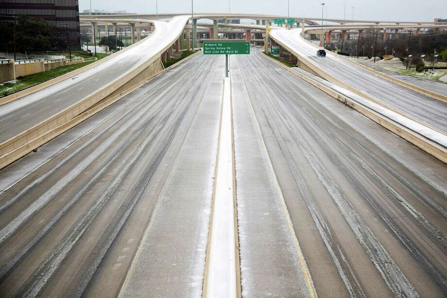 A vehicle drives on the High Five Interchange, Monday, Feb. 23, 2015, in Dallas. Freezing rain affected travel in nearly half of Texas on Monday, and winter storm warnings were issued in the northern part of the state. (AP Photo/The Dallas Morning News, Smiley N. Pool)  MANDATORY CREDIT; MAGS OUT; TV OUT; INTERNET USE BY AP MEMBERS ONLY; NO SALES Photo: Smiley N. Pool, AP / The Dallas Morning News