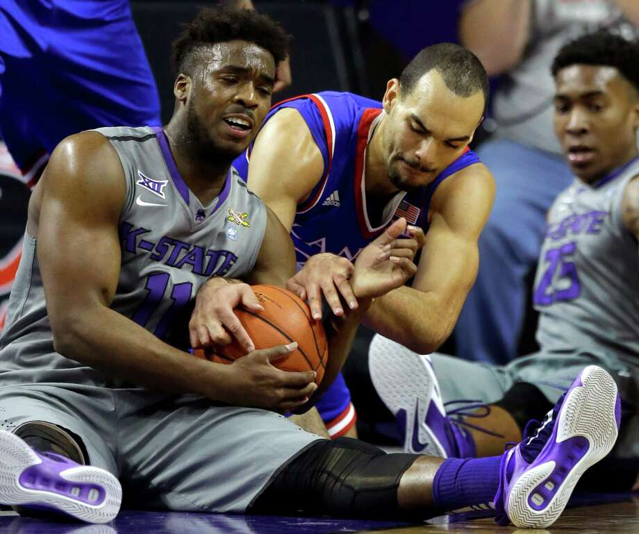 Kansas State's Nino Williams, left, and Kansas' Perry Ellis struggle for control in the Wildcats' victory. Photo: Orlin Wagner, STF / AP