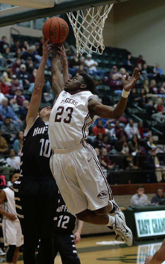 Silsbee's Tavious Grubbs lays up the ball against Huffman Hargrave at East Chambers High School on Monday.  Photo taken Monday, February 23, 2015   Guiseppe Barranco/The Enterprise Photo: Guiseppe Barranco, Photo Editor