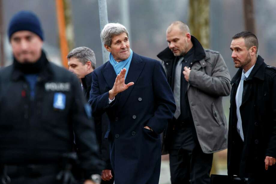 U.S. Secretary of State John Kerry, center, returns to his hotel after walking on the bank of Lake Geneva, following a bilateral meeting with Iranian Foreign Minister Mohammad Javad Zarif for a new round of nuclear talks in Geneva, Switzerland, Monday, Feb. 23, 2015. (AP Photo/Keystone, Salvatore Di Nolfi) ORG XMIT: SDN201 Photo: Salvatore Di Nolfi / Keystone