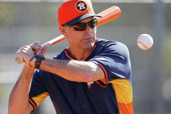 Houston Astros bench coach Trey Hillman (22) during spring training workouts for pitchers and catchers at their Osceola County training facility, Sunday, Feb. 22, 2015, in Kissimmee.
