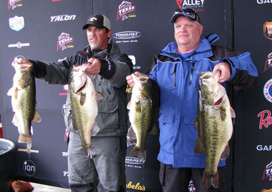 Bart Blakelock and James Benedict with some of their 35.56 lb sack and their 11.42 lb lunker. photo by Jim Binns