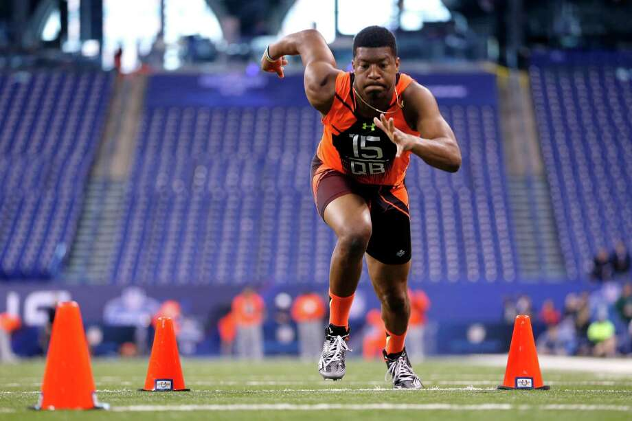 Florida State quarterback Jameis Winston runs a drill at the NFL football scouting combine in Indianapolis, Saturday, Feb. 21, 2015. Photo: Julio Cortez /Associated Press / AP
