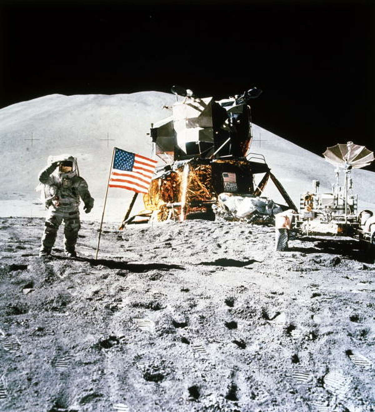 Astronaut James Irwin, with the Lunar Rover and the Lunar Module nearby, salutes the American flag planted on the surface of the Moon. Mount Hadley can be seen in the background. Apollo 15, the fourth successful lunar landing mission, was launched on 26th July 1971. It carried astronauts David Scott, Irwin and Alfred Worden. Worden remained in lunar orbit in the Apollo Command Module while the other two astronauts descended to the Moon, becoming the seventh and eighth men to walk on its surface. Apollo 15 was the first mission to use the battery powered Lunar Rover which, with a top speed of 14 kilometres per hour, considerably increased the distances that astronauts could cover while exploring the lunar surface.