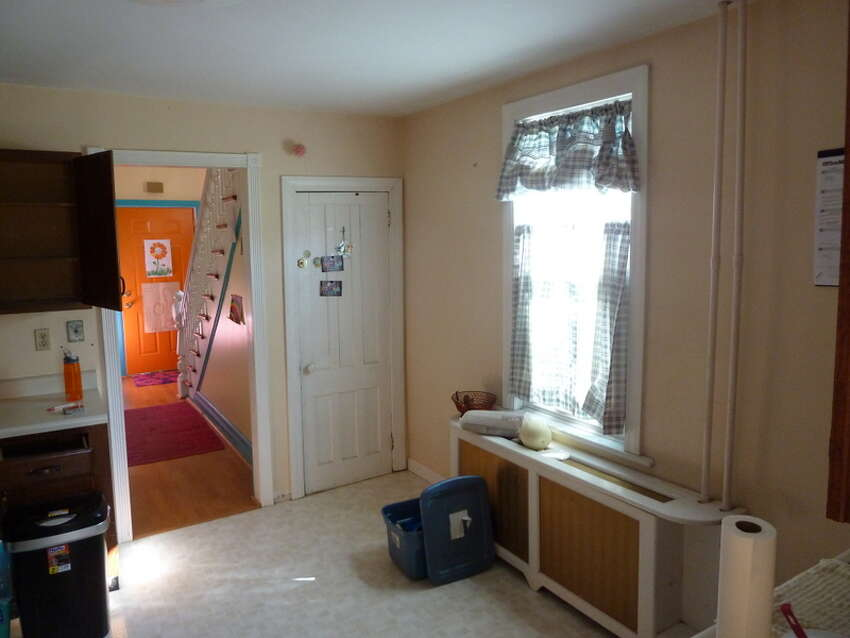 The entrance to the hallway and the window with radiator below remain intact but looking much nicer.