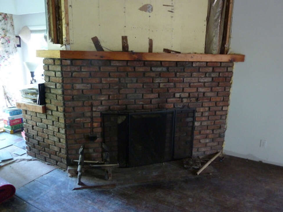 Before - dining room fireplace - a whole lotta brick.