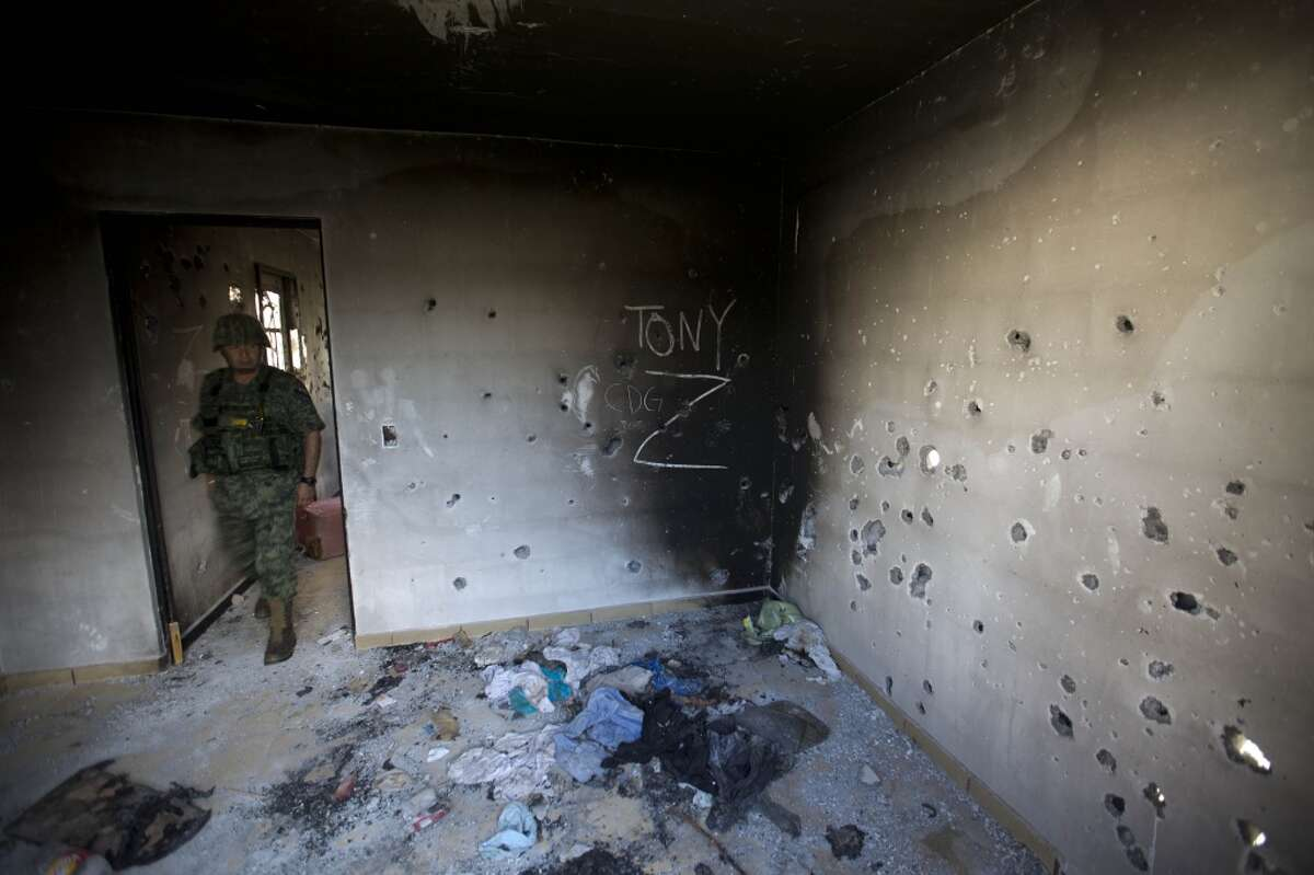 1. Home Town Boys: The Gulf Cartel has long considered Matamoros, located just across the Rio Grande from Brownsville, to be its main base of operations. Generations of leaders were raised there and in the vicinity. In this September 2014 photo, a soldier enters a bullet-riddled home covered by the initials of the Gulf Cartel (CDG) and Zetas (Z) in Ciudad Victoria, Tamaulipas state, Mexico. According to the soldiers, the home was destroyed in a firefight between government security forces and the Gulf Cartel. (AP Photo/Eduardo Verdugo)