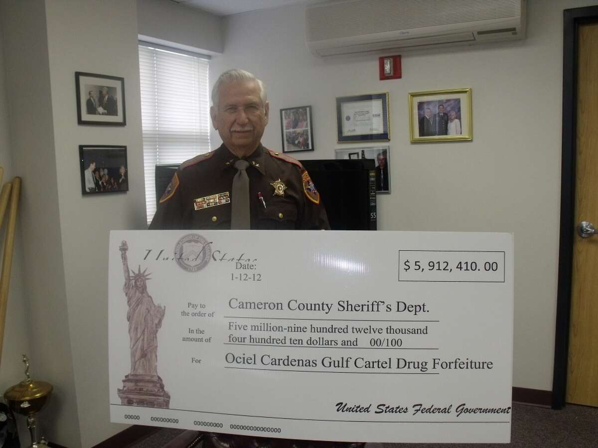 This is a photo of Sheriff Omar Lucio in Cameron County accepting his department's $5.9 million share of federal forfeiture proceeds from the Osiel Cardenas case in 2012. It is part of an estimated $29 million out of $50 million in funds that Cardenas, former leader of Mexico's powerful Gulf Cartel, agreed to forfeit as part of his 2010 sentencing agreement. (Photo courtesy Cameron County Sheriff's Office.)