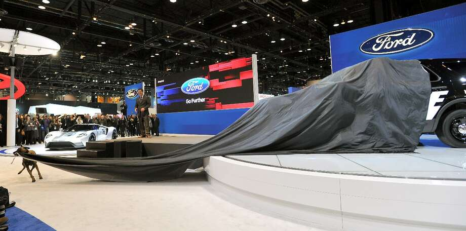 On command, Keegan the Belgian Malinois shepherd literally unveiled Ford's new 2016 Police Interceptor SUV for the media on Feb. 12, 2015, at the Chicago Auto Show. Photo: Ford Motor Company