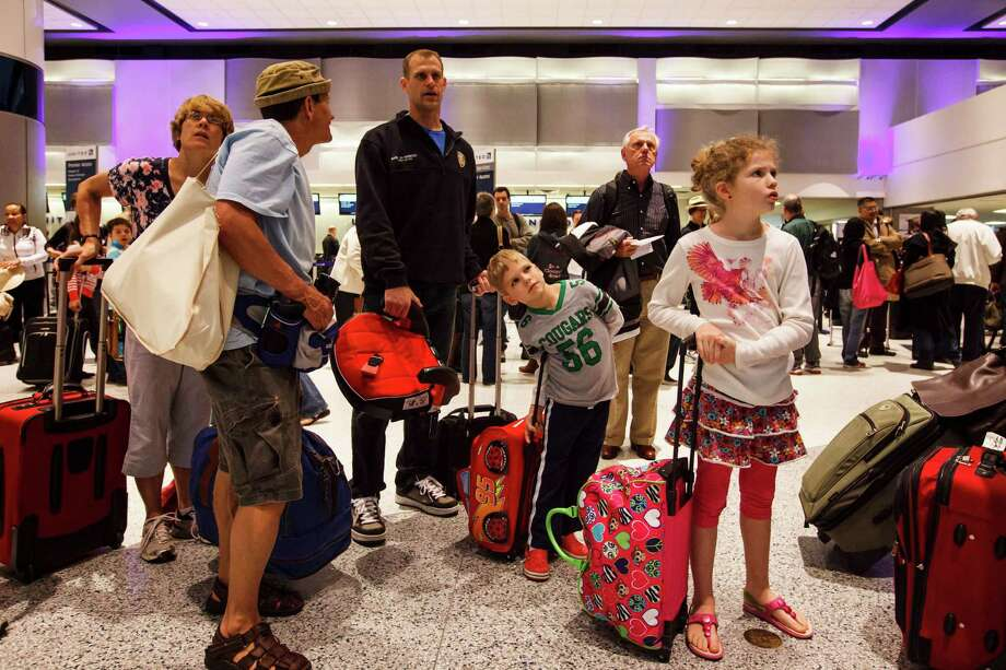 If flying is part of the plan, discuss the various aspects of airport safety, moving through security and ensuring your child will be comfortable on board. Photo: Michael Paulsen, Staff / © 2012 Houston Chronicle