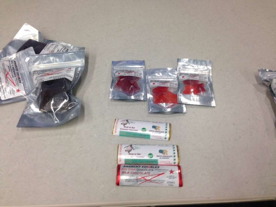 San Antonio police confiscated $100 worth of marijuana-laced products, including gummies, brownies and chocolate bars, from an Amtrak station at 350 Hoefgen Avenue on February 23, 2015. Photo: Mark D. Wilson/San Antonio Express-News