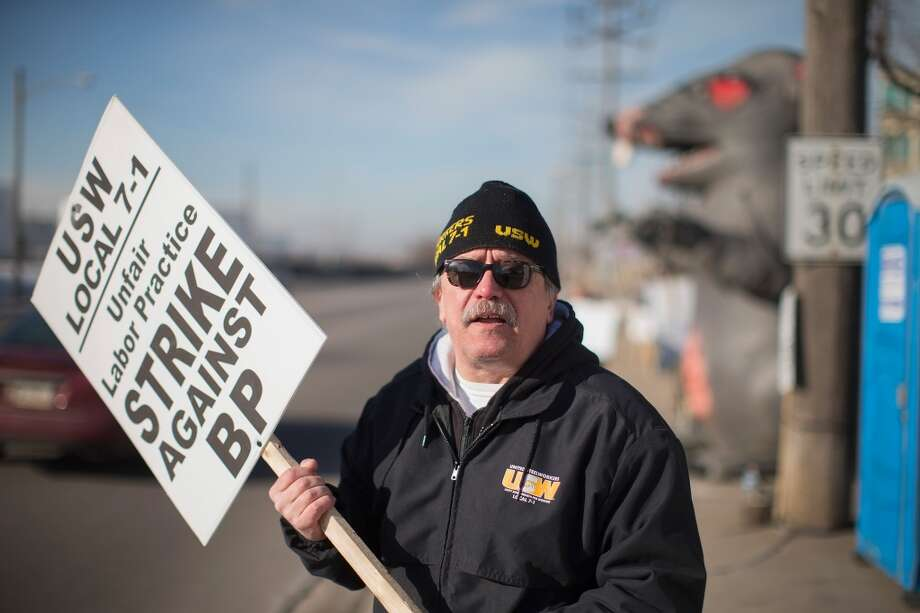 WHITING, IN - FEBRUARY 10:  Members of the United Steelworkers Union and other supporting unions picket outside the BP refinery on February 10, 2015 in Whiting, Indiana. Workers at the BP refinery walked off the job Sunday morning after failing to reach an agreement on a new contract. They join workers at nine other oil refineries and plants in the first nationwide refinery strike since 1980.  (Photo by Scott Olson/Getty Images) Photo: Scott Olson, Getty Images