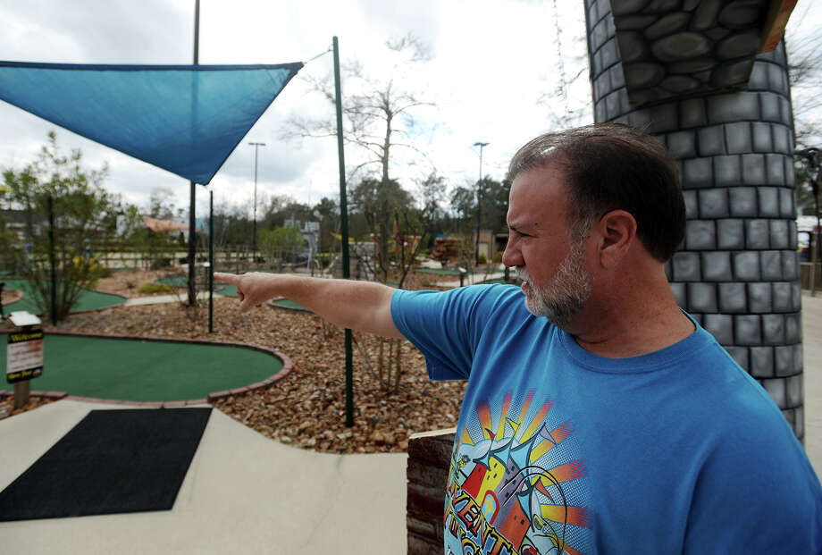 Owner Marlon Quibodeaux points out some of the handicapped accessibility features in Adventure Kingdom's putt-putt golf course Saturday afternoon. Adventure Kingdom in Lumberton has been operating since 2007 and offers putt-putt golf, bumper cars, and other amusements. Photo taken Saturday 2/7/15 Jake Daniels/The Enterprise Photo: Jake Daniels / ©2014 The Beaumont Enterprise/Jake Daniels
