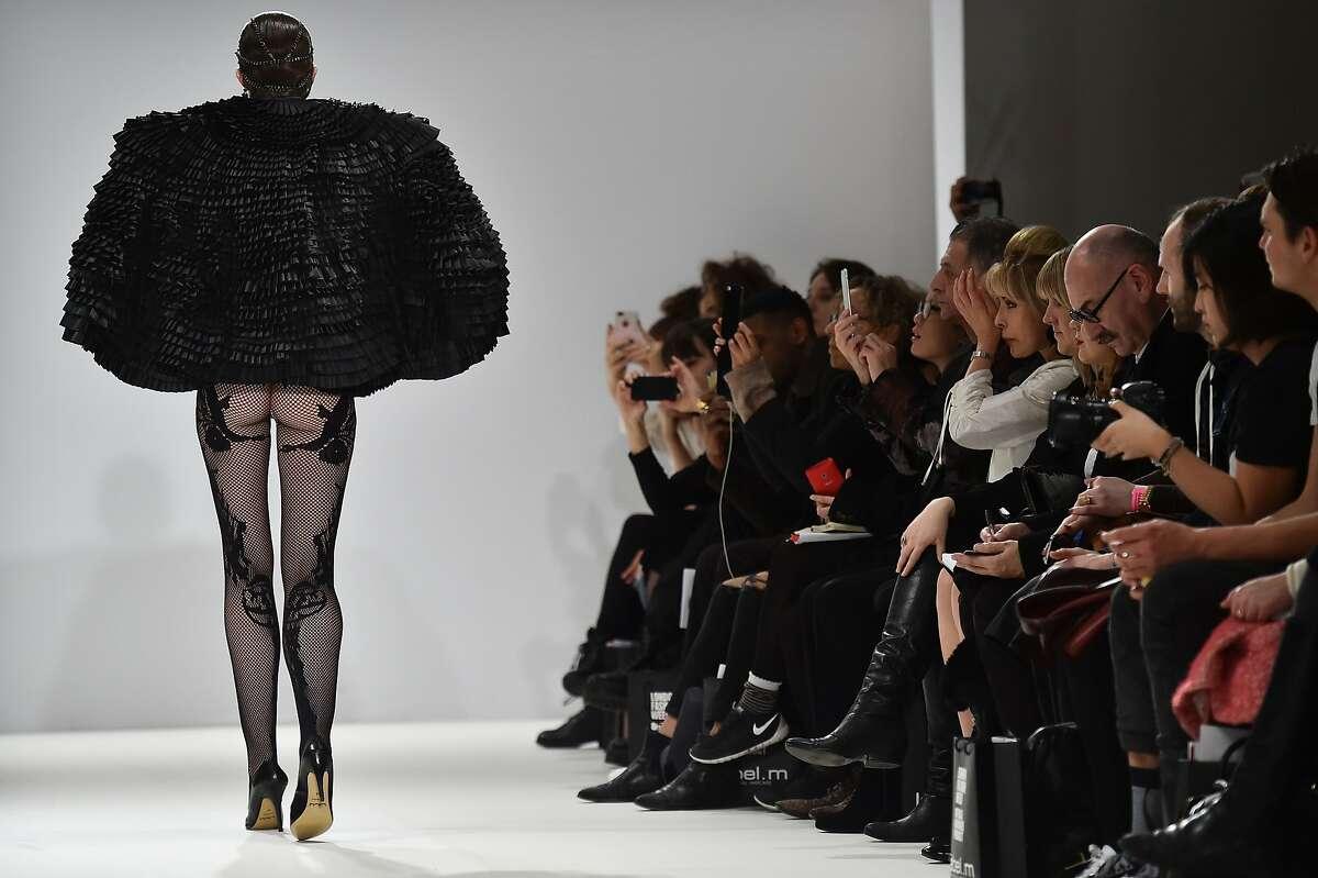 MARKO MITANOVSKI'S BOTTOM LINE: A model presents a creation by Serbian designer Marko Mitanovski that's heavy on top but skimpy below the waist at London Fashion Week.