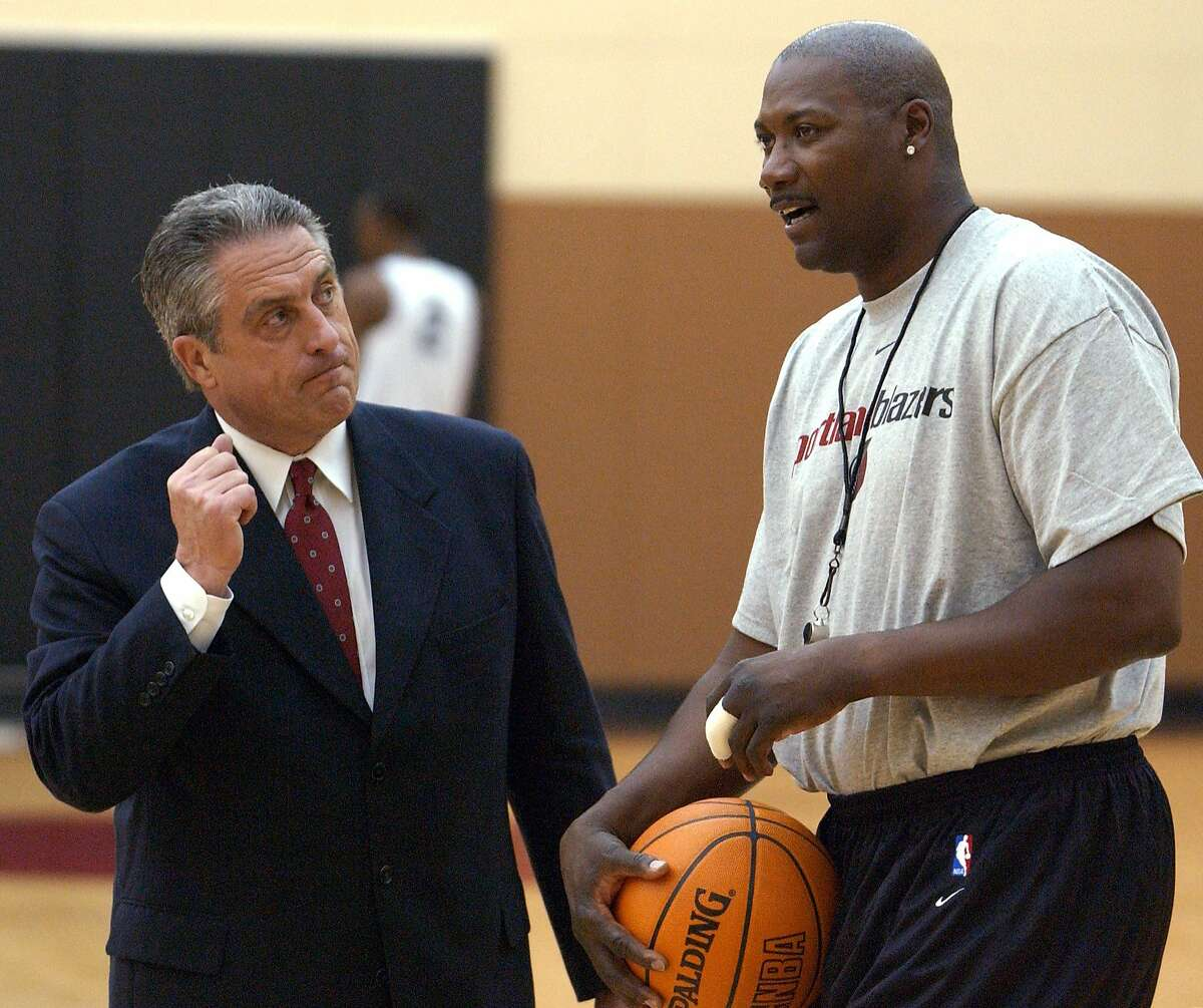 FILE - In this July 16, 2003, file photo, Portland Trail Blazers general manager John Nash, left, chats with assistant coach Jerome Kersey after the NBA basketball team's practice in Tualatin, Ore. Kersey, the small forward who played his first 11 NBA seasons with the Trail Blazers and helped the San Antonio Spurs win the 1999 title, has died. He was 52. The Trail Blazers confirmed Wednesday night, Feb. 18, 2015, that Kersey had died, but didn't provide details. (AP Photo/Greg Wahl-Stephens, File)