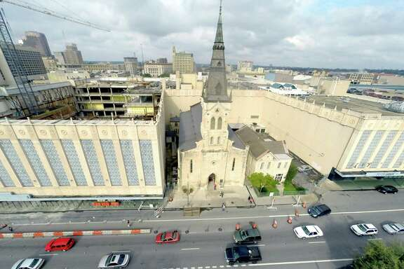 St. Joseph Catholic Church on Commerce Street in downtown San Antonio is seen Feb. 15, 2015, in aerial pictures taken from a quadcopter. The former Joske's building can be seen at left and theRivercenter Mall is at right of the church.