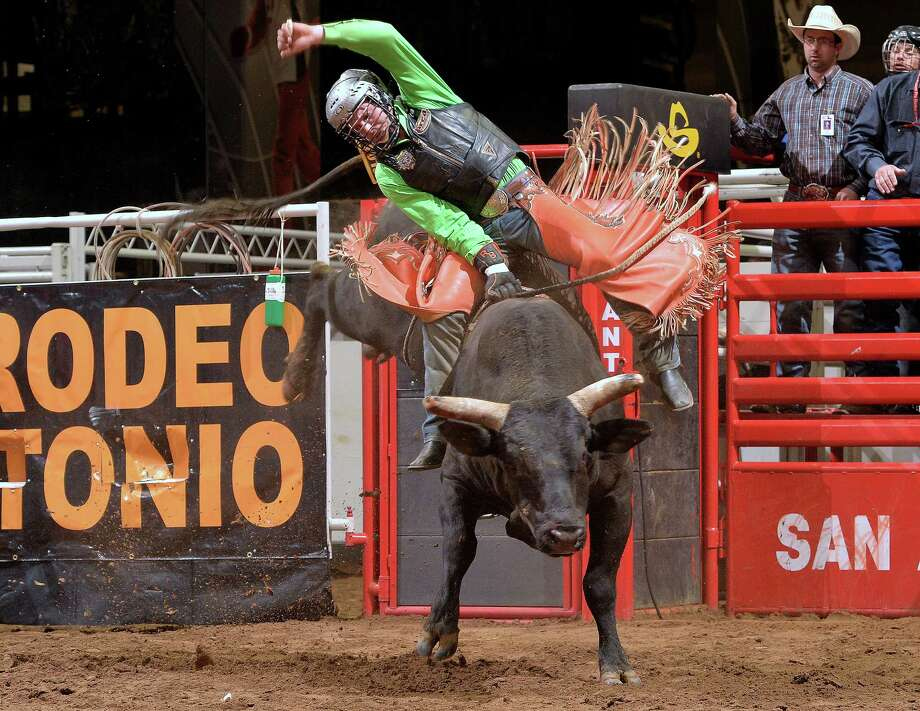 Reid Barker, from Comfort, rides the bull Wells Fargo on Saturday, Feb. 21, 2015, at the AT&T Center. Photo: Courtesy Photo /Greg Westfall, PRCA / Westfall PHOTO    2013