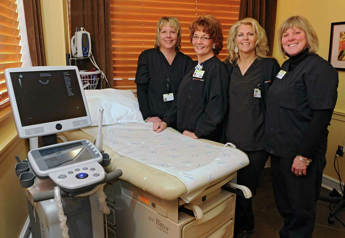 Nurses Justine Taylor, Stacey Dicerbo, Greta Joost and ultrasonographer Sheila Miller stand in an examination room at CNY Fertility on Friday, Feb. 20, 2015 in Latham, N.Y. (Lori Van Buren / Times Union)