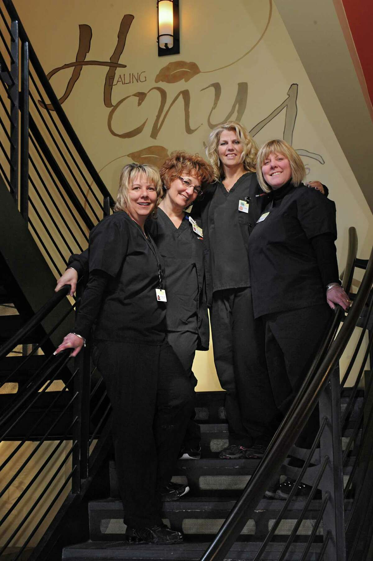 Nurses Justine Taylor, Stacey Dicerbo, Greta Joost and ultrasonographer Sheila Miller stand on the stairs at CNY Fertility on Friday, Feb. 20, 2015 in Latham, N.Y. (Lori Van Buren / Times Union)