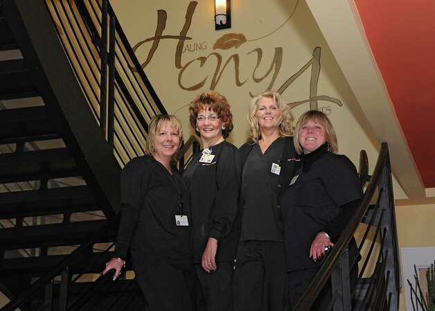 Nurses Justine Taylor, Stacey Dicerbo, Greta Joost and ultrasonographer Sheila Miller stand on the stairs at CNY Fertility on Friday, Feb. 20, 2015 in Latham, N.Y.  (Lori Van Buren / Times Union) Photo: Lori Van Buren / 00030558A